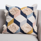navy and pink geometric patterned pillow with texture