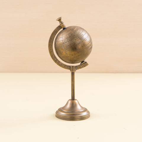small brass metal globe on stand