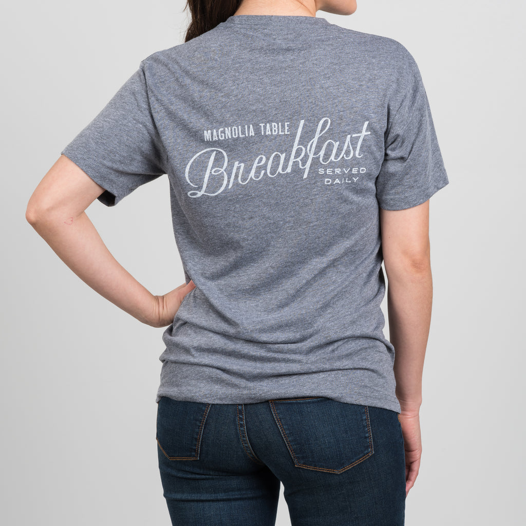 "magnolia table shirt that says ""Breakfast served daily"" on the back"