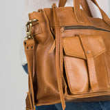 brown leather satchel with pockets