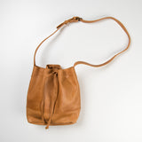 caramel leather bag with long shoulder strap