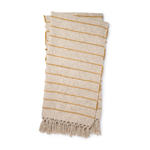 beige linen colored throw blankets with small gold stripes and tassel fringe