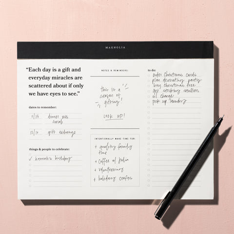 white notepad with various intentional sections