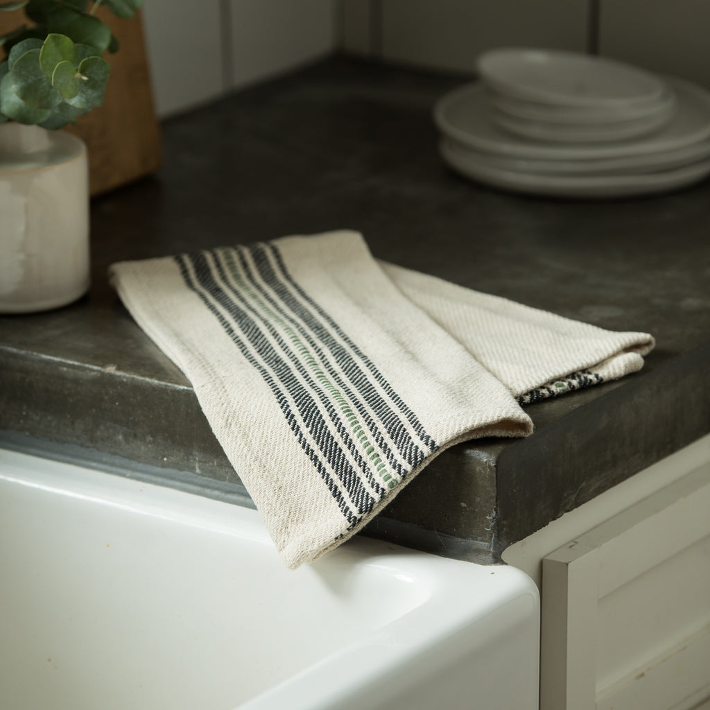 natural colored cotton towel with black and green stripes