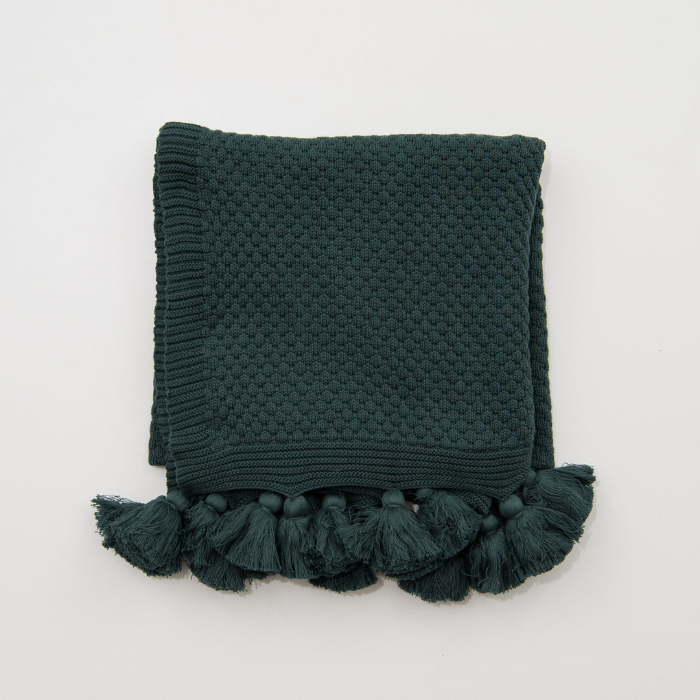 green throw with tassels