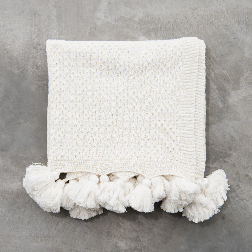 white throw with tassels