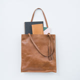 brown leather tote with tassel