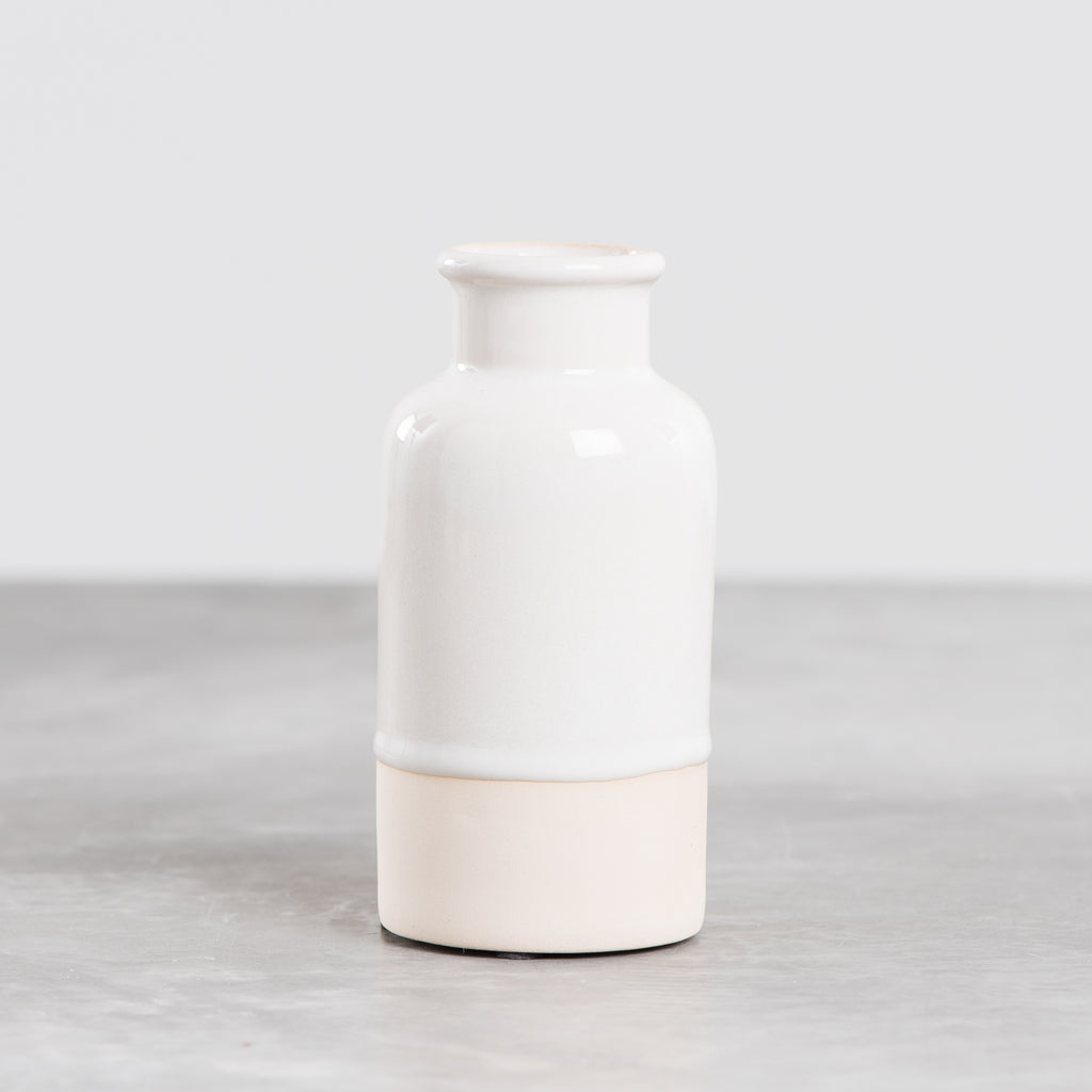 white and cream apothecary style ceramic vase
