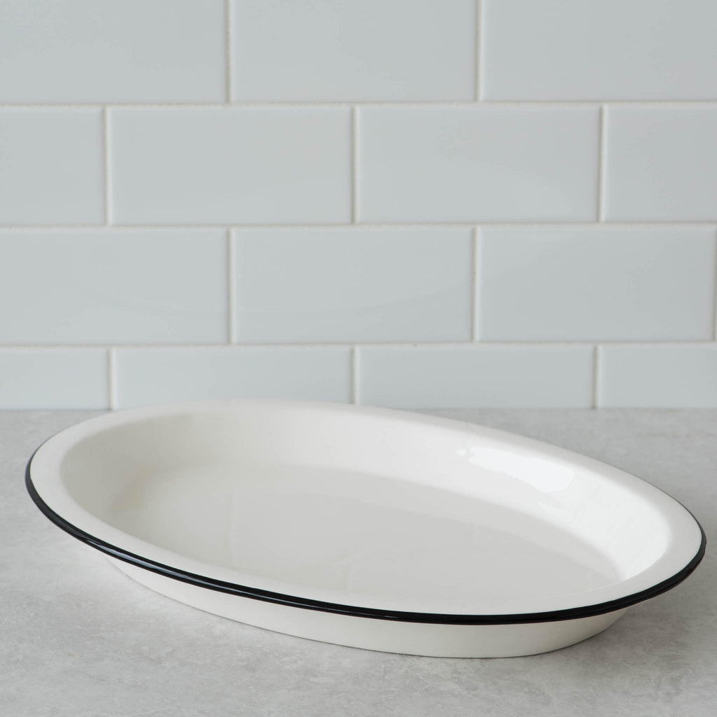white ceramic oval platter with black rim