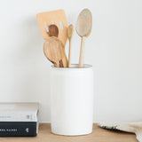 white ceramic utensil holder with black rim