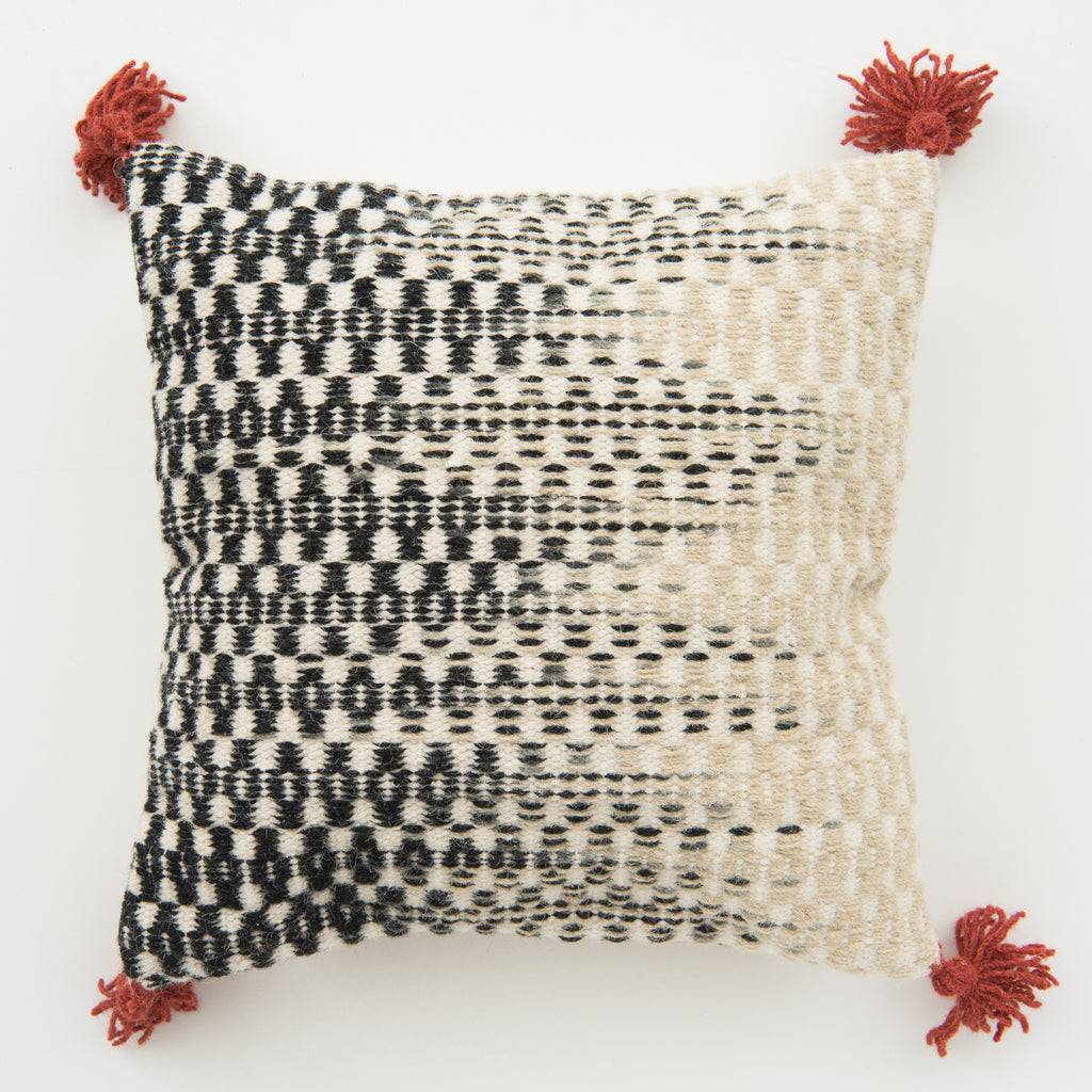 modern black to white ombre patterned pillow with red tassels