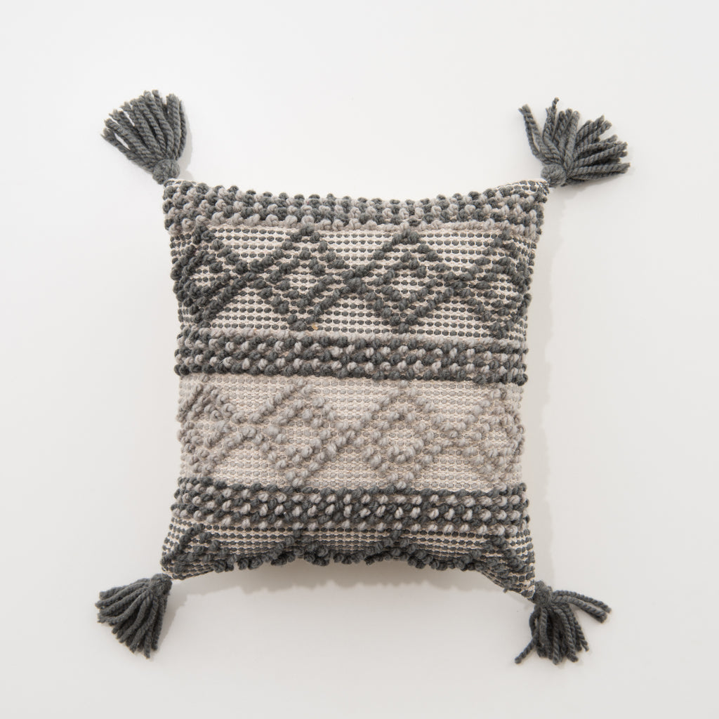 square charcoal pillow with diamonds and tassels
