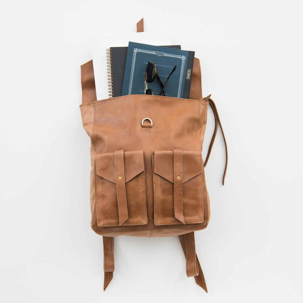 brown leather backpack with pockets