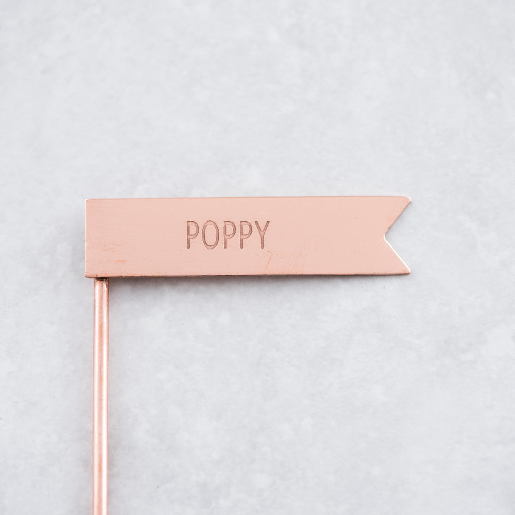 copper metal poppy plant marker