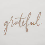 "copper script sign reading ""grateful"""