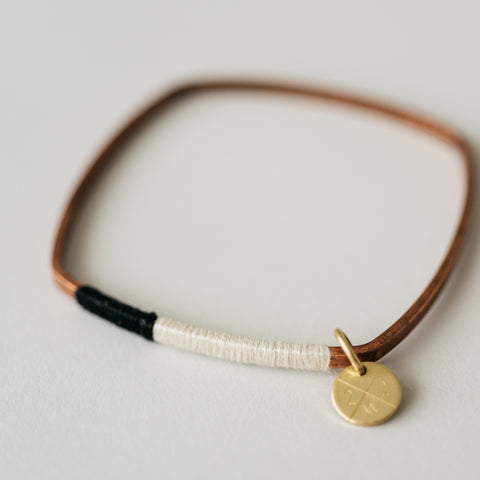 square copper bangle bracelet with cotton thread detail
