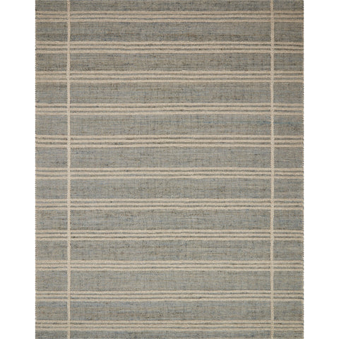 grey-blue area rug with cream lined detail