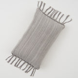 light grey cotton pillow with tassels