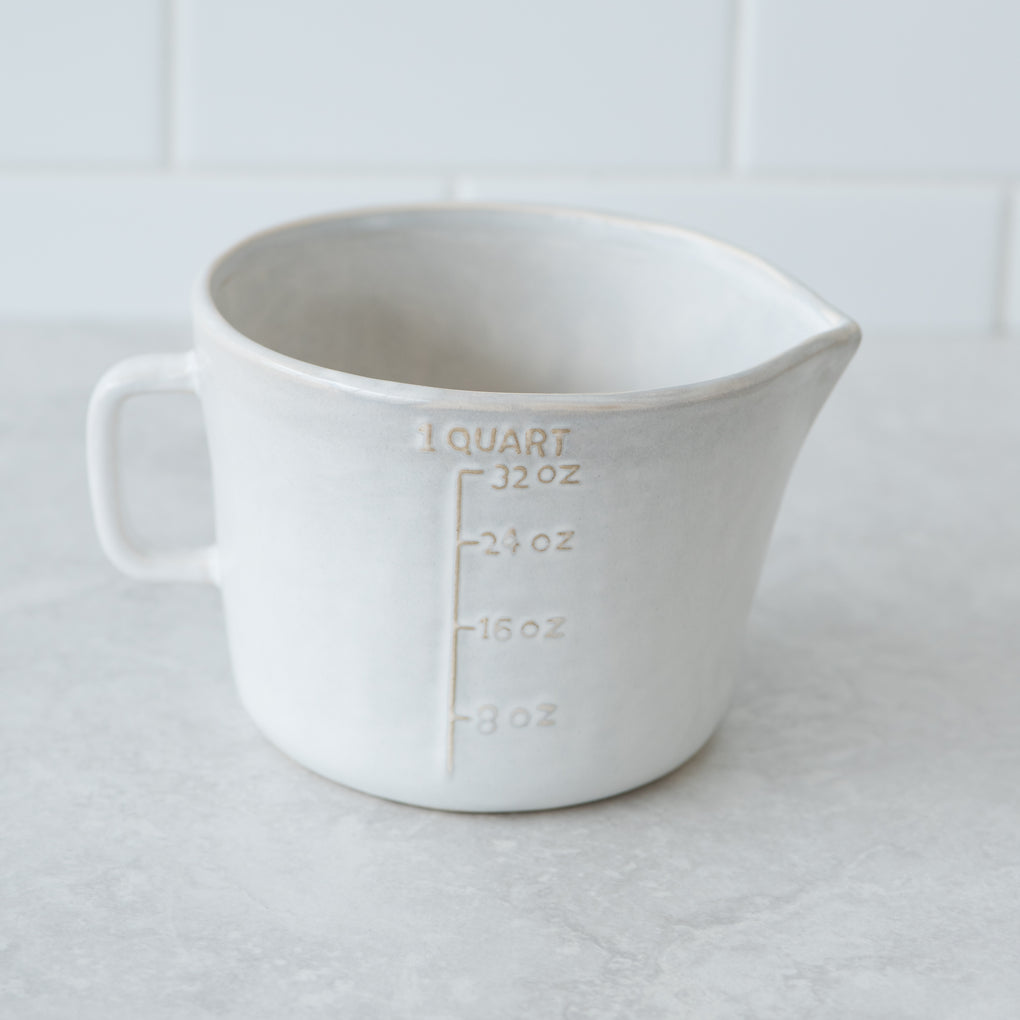 cream ceramic measuring quart with handle and embossed measuring numbers