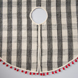 black and white plaid tree skirt with red pom pom fringe
