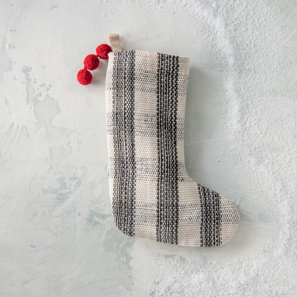 black and cream plaid stocking with red pom poms