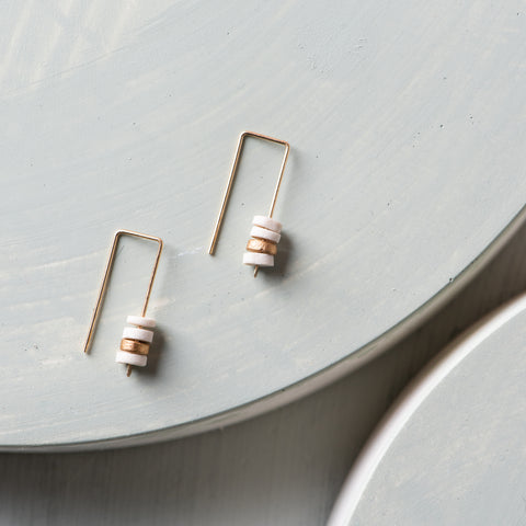 dangly earrings with tiny stack of circular ceramic pieces