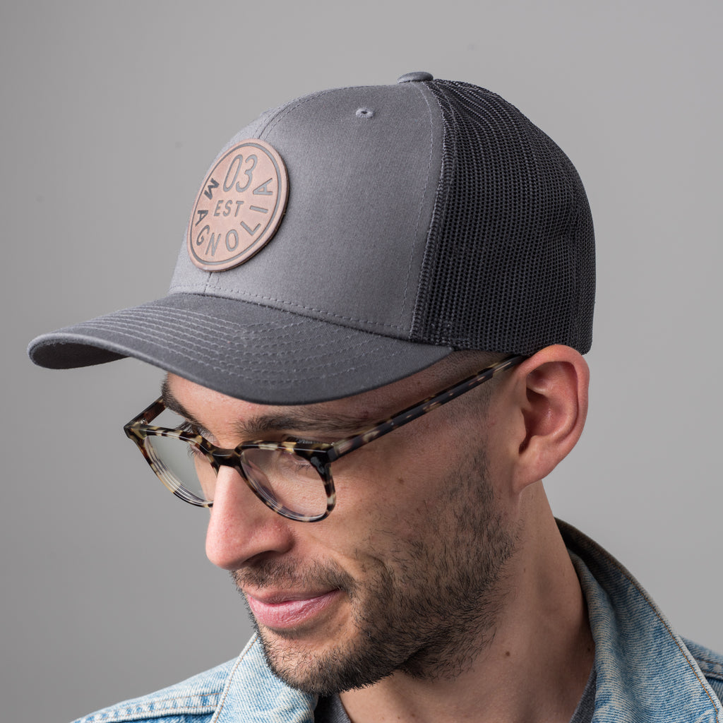 gray magnolia trucker patch with leather logo patch