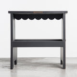 dark grey wooden stepping stool with scalloped edge