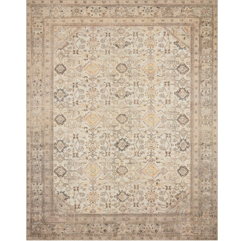 tan and cream distressed traditional rug with floral detail