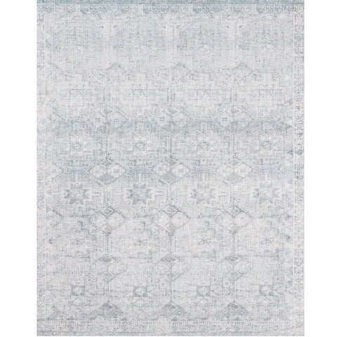 light blue and distressed area rug with faded southwestern detail