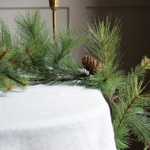 artificial pine garland with pine cones