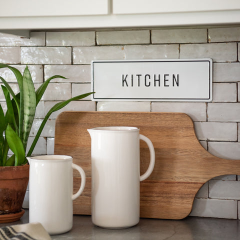 "white and black metal embossed sign that reads ""kitchen"""