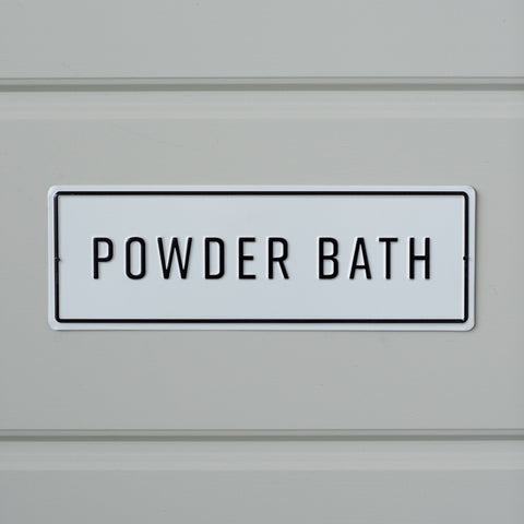 "white and black metal embossed sign that reads ""powder bath"""