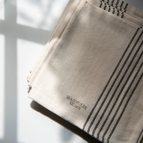 linen napkins with dark grey embroidered stripes