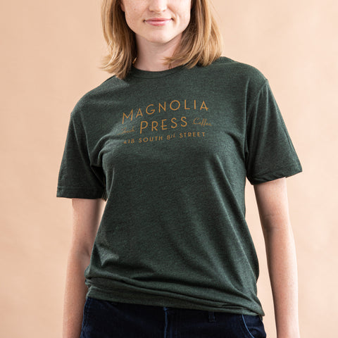 emerald green t-shirt with magnolia press coffee logo in gold across chest