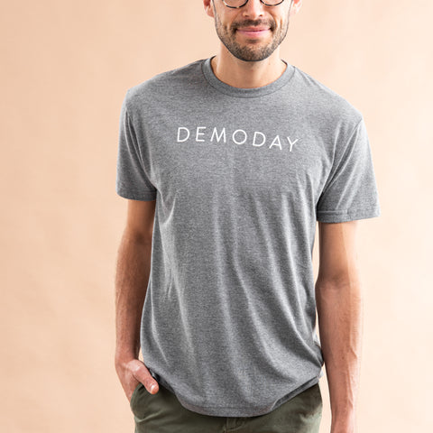 "heathered grey shirt with ""DEMODAY"" in white all caps across chest"
