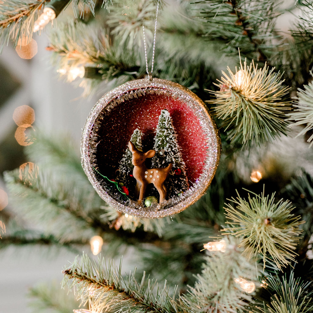 glass ornament with fawn figurine