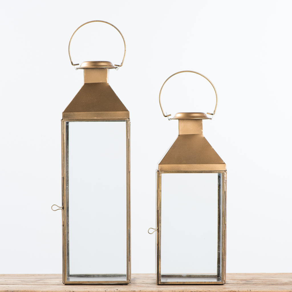 brass metal and glass lantern