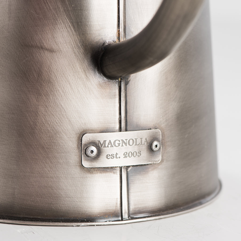 silver metal watering can