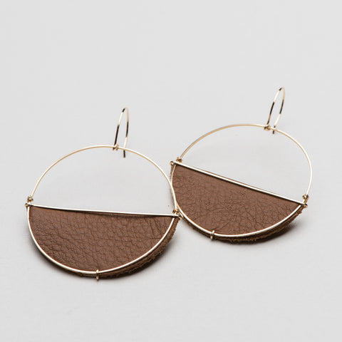 gold circle hoop earrings with half-moon leather piece