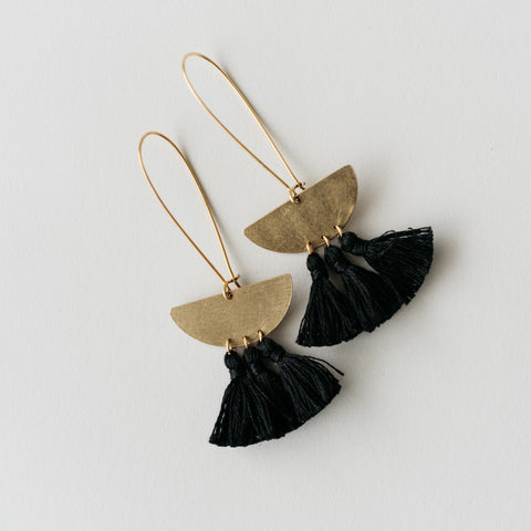 gold dangle earrings with half moon pendant and black tassels