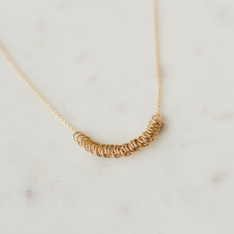 gold necklace with small hoop pendants