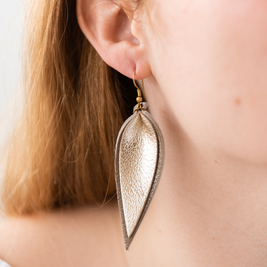 gold metallic leather layered leaf shaped earrings