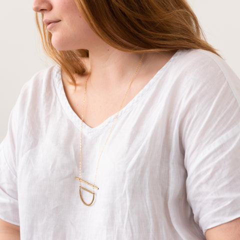 brass necklace with brass bar and semi circle pendant
