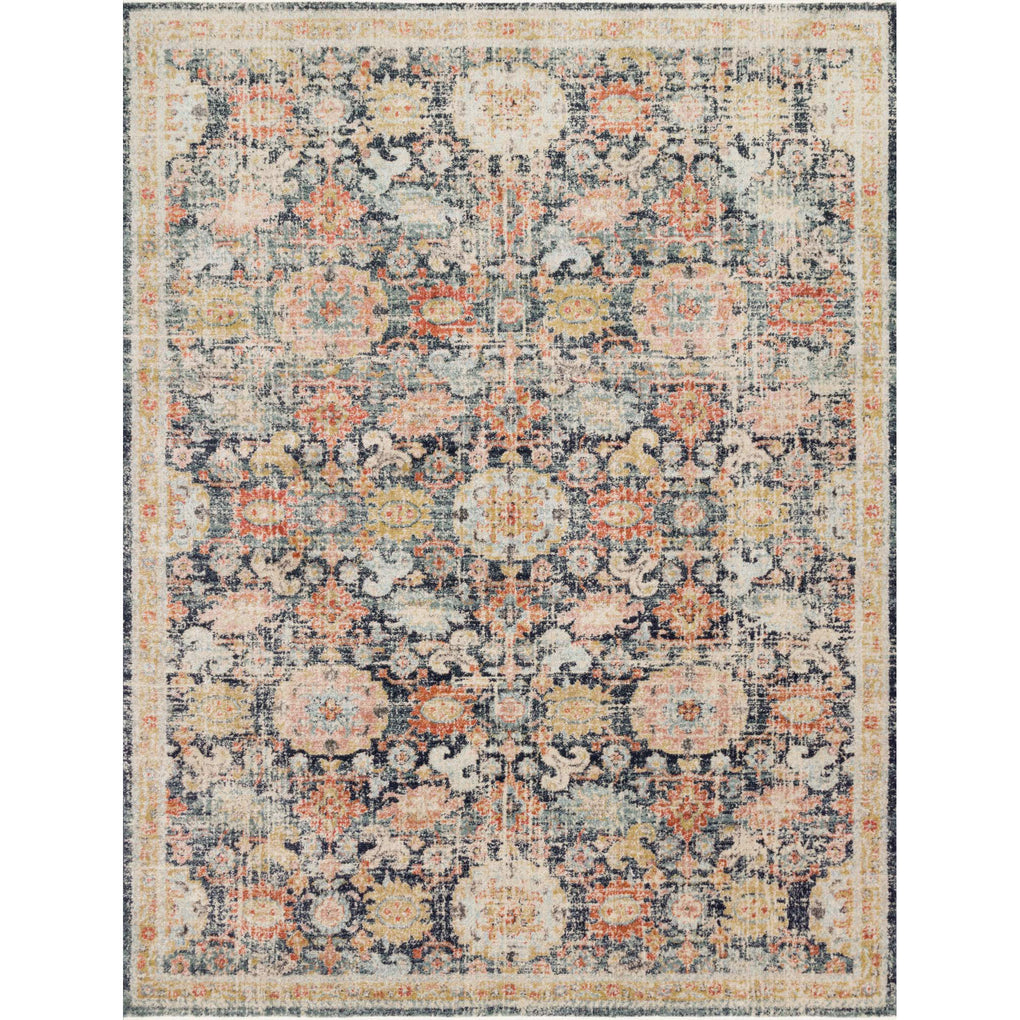 distressed navy rug with multi-colored detail