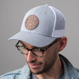 gray and white magnolia trucker hat with leather patch