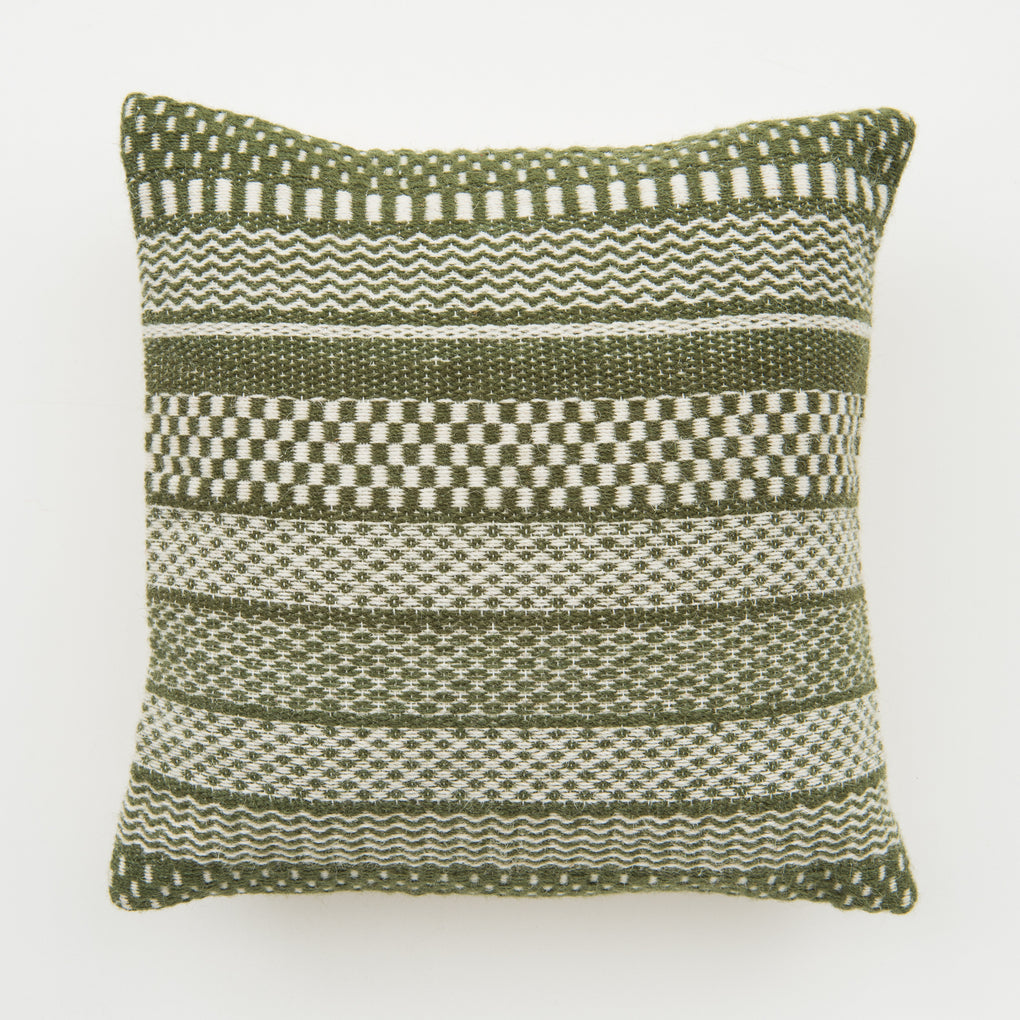 green and white striped pattern pillow with white tassels