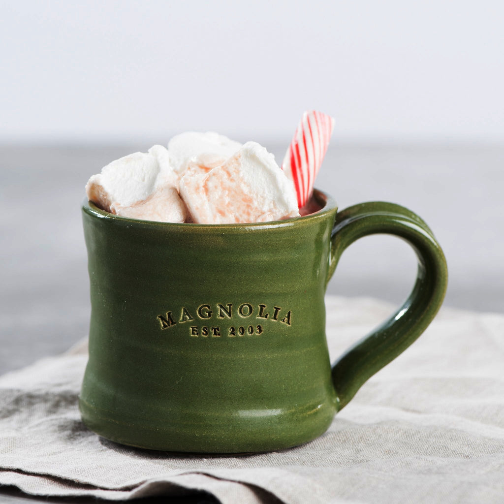 green ceramic holiday coffee mug