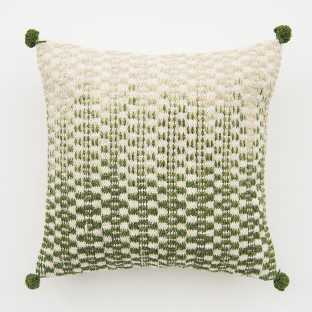 green to white ombre patterned pillow with green corner tassels