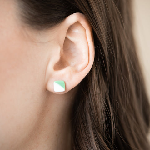 square stud ceramic earrings that are half green and half cream